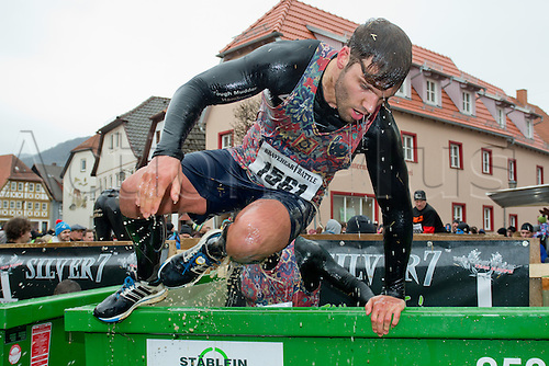 12.03.2016. Bischofsheim, Germany.  A participant of the extreme run Braveheart Battle climbing a water obstacle in Bischofsheim, Germany. Almost 2,700 runners have to manage a 30 kilometer track with 45 obstacles. The extreme run event leads through ice cold water, deep mud pits and hot fire obstacles. It is said to be one of the hardest in Europe.