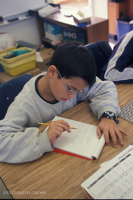 Berkeley CA 4th grader doing independent writing in class