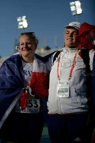 14.07.2012 Barcelona, Spain. Alexandra TAVERNIER (left) and Alexandra TAVERNIER of France silver and gold medal in the Hammer Throw for women Final during day 5 of the IAAF World Junior Championships from the Montjuic Olympic Stadium in Barcelona.