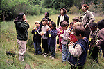 Berkeley CA Park ranger instructing 1st graders and parent volunteers about insects on nature field trip to local regional park