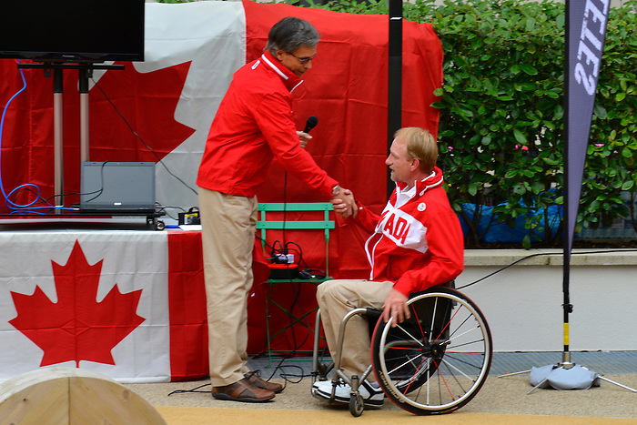 LONDON, ENGLAND 26/08/2012 - Gaetan Tardif, Chef de Mission, congratulates Garett Hickling of Wheelchair Rugby on being announced as the flag bearer for the Opening Ceremonies during a pep rally at Canada House at the London 2012 Paralympic Games. (Photo: Phillip MacCallum/Canadian Paralympic Committee)