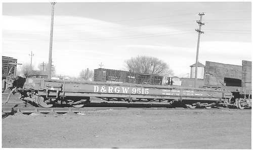 Side view of D&amp;RGW idler flatcar #9515 at Alamosa.  Stock cars #5960 &amp; 5709 are in the background.<br /> D&amp;RGW  Alamosa, CO  Taken by Richardson, Robert W. - 1/1955