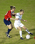 Lindsay Tarpley (25) holds off Erin Baxter at SAS Stadium in Cary, North Carolina on 3/22/03 during a game between the Carolina Courage and University of North Carolina Tarheels.