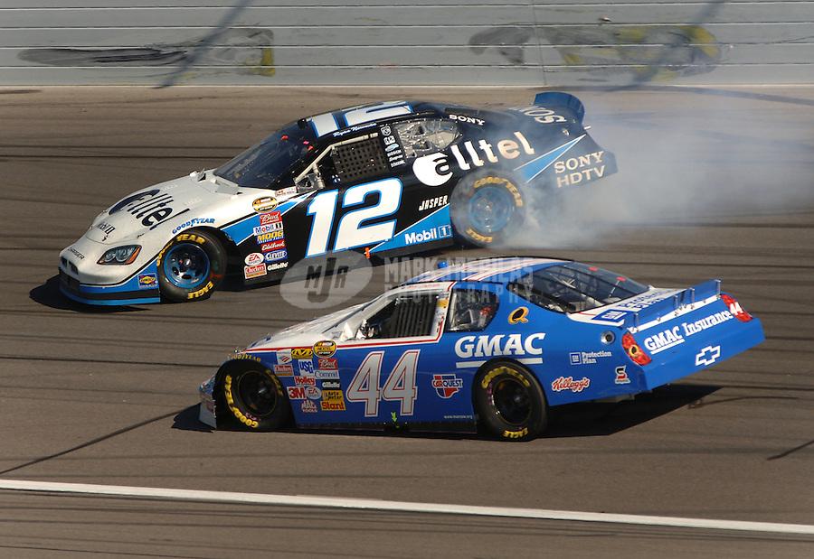 Oct 1, 2006; Kansas City, KS, USA; Nascar Nextel Cup driver Ryan Newman (12) spins in front of Terry Labonte (44) during the Banquet 400 at Kansas Speedway. Mandatory Credit: Mark J. Rebilas
