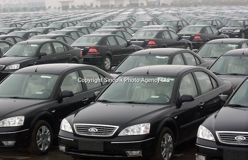 Ford cars are lined-up outside Chongqing Changan Automobile, the country's third-largest vehicle maker, outside the Chongqing plant.  American car manufacturer Ford has formed into a joint venture with the Chinese manufacturer.