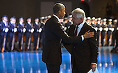 United States President Barack Obama (L) embraces outgoing U.S. Secretary of Defense Chuck Hagel during an Armed Forces Farewell Tribute, January 28, 2015 at Joint Base Myer-Henderson Hall, Virginia. Deputy Secretary Ashton Carter, who has served under Leon Panetta and Hagel is expected to be easily approved by the Senate to succeed Hagel.<br /> Credit: Mike Theiler / Pool via CNP