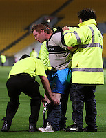A pitch invader is removed after the match during 2nd Twenty20 cricket match match between New Zealand Black Caps and West Indies at Westpac Stadium, Wellington, New Zealand on Friday, 27 February 2009. Photo: Dave Lintott / lintottphoto.co.nz