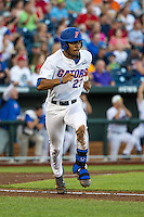 Buddy Reed (23) of the Florida Gators runs during a game between the Miami Hurricanes and Florida Gators at TD Ameritrade Park on June 13, 2015 in Omaha, Nebraska. (Brace Hemmelgarn/Four Seam Images)