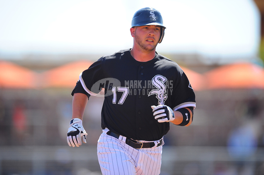 Mar. 14, 2012; Phoenix, AZ, USA; Chicago White Sox batter Tyler Flowers rounds the bases after hitting a solo home run in the second inning against the Anaheim Angels at The Ballpark at Camelback Ranch. Mandatory Credit: Mark J. Rebilas-
