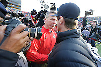 Coach Urban Meyer meets Michigan coach Jim Harbaugh and a gaggle of photographers after the game at Michigan Stadium on November 28, 2015. (Chris Russell/Dispatch Photo)