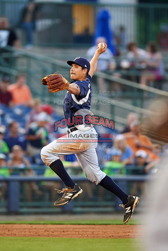 Pensacola Blue Wahoos third baseman Seth Mejias-Brean (5) makes a bare handed over the shoulder grab on a hopper during a game against the Mississippi Braves on May 28, 2015 at Trustmark Park in Pearl, Mississippi.  Mississippi  defeated Pensacola 4-2.  (Mike Janes/Four Seam Images)