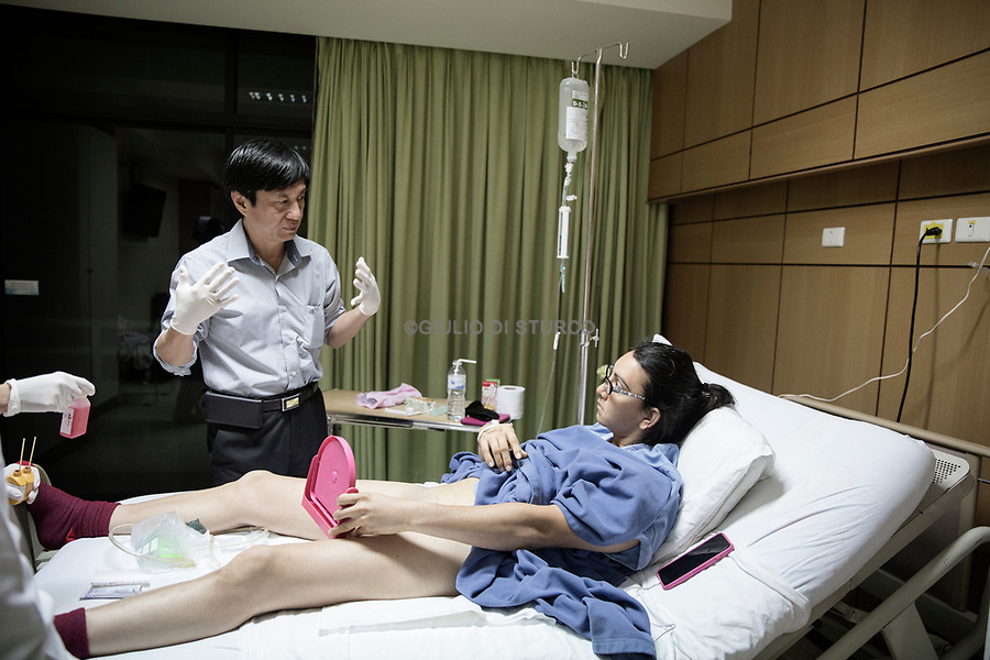 Dr Suporn Watanyusakul shows patient Olivia Thomas her new vagina after gender reassignment surgery at a hospital in Chonburi, near Bangkok, Thailand.<br /> <br /> Thailand leads the world as a medical tourism destination, with gender-affirming surgery forming a strong niche. Treatment can be considerably cheaper than in other countries around the world, and the large numbers of patients mean that surgeons become highly experienced. The use of new technologies and procedures is also often given as a reason for Thailand's popularity among people seeking treatment for gender dysphoria.