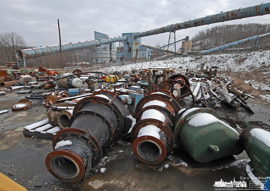 Used mining equipment lays in a field Saturday, Jan. 7, 2006, at the Sago mine cleaning facility buildings at the Buckhannon, WV, mine where 12 miners died in an explosion. (Gary Gardiner/EyePush Newsphotos)<br />