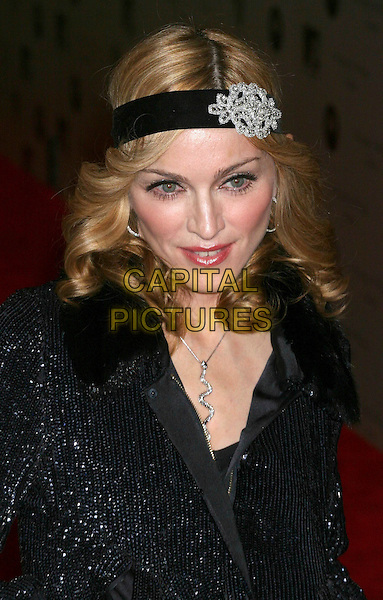 "MADONNA.Premiere ""I'm Going To Tell You A Secret"" at the Loews Lincoln Center, New York City..STUART PRICE.October 18th, 2005.Ref: IW.headhsot portrait black diamond brooch clasp alice band headband head band.www.capitalpictures.com.sales@capitalpictures.com.©Capital Pictures"