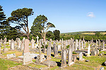 Gravestones in churchyard parish church at St Keverne, Lizard Peninsula, Cornwall, England, UK