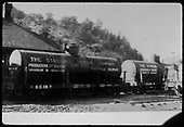 Standard Chemical tank cars #7 and #6 behind Placerville depot.  It is not known whether these cars actually transported the radium, uranium and vanadium stated on the tank sides or if they were used for other purposes, possibly &quot;oil for engines&quot; (mill generators) as stated in a book by Rimrocker Historical Society.<br /> RGS  Placerville, CO  ca. 1920