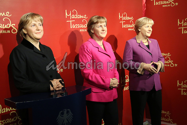 16 November 2015 - Berlin, Germany - Madame Tussauds Berlin displays three wax figurines of German chancelor Dr Angela Merkel. The politician has her 10-year-anniversary of being in office. Since wax figurines cannot age with their role model, three different figurines represent her in three different terms. Photo Credit: Tamara Bieber/face to face/AdMedia