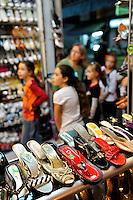 Woman and children browsing in shoe store, Da Lat, Vietnam