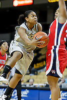 January 27, 2011: Houston forward Lesslee Mason (33) defends as Central Florida guard Geneva Carter (5) drives the basket during first half womens Conference USA NCAA basketball game action between the Houston Cougars and the Central Florida Knights at the UCF Arena Orlando, Fl.