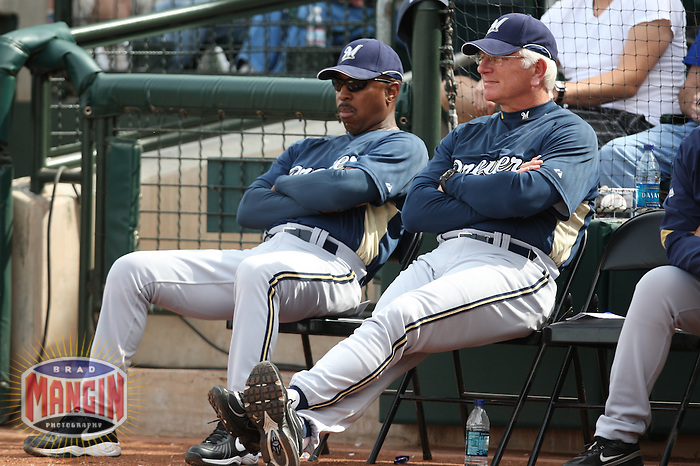 SURPRISE, AZ - MARCH 8:  Manager Ken Macha of the Milwaukee Brewers watches from the dugout during their spring training game against the Kansas City Royals at Surprise Stadium in Surprise, Arizona on March 8, 2009.  Photo by Brad Mangin