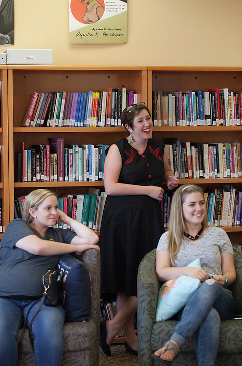 From left, Brielle Clark, Dr. M. Geneva Murray, and Christie Thiessen listen to another graduate student speak at the Women in Graduate School Coffee Hour in the Women's Center on Tuesday, September 6, 2016.