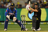 1st November 2019; Melbourne Cricket Ground, Melbourne, Victoria, Australia; International T20 Cricket, Australia versus Sri Lanka; David Warner of Australia smashes a boundary - Editorial Use