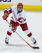 Andrew Joudrey 24 of the University of Wisconsin moves the puck. The Boston College Eagles defeated the University of Wisconsin Badgers 3-0 on Friday, October 27, 2006, at the Kohl Center in Madison, Wisconsin in their first meeting since the 2006 Frozen Four Final which Wisconsin won 2-1 to take the national championship.<br />