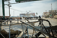 03 January, 2014 - Phnom Penh. Police walk past one of the barricade garment factory workers built to block the road. © Thomas Cristofoletti / Ruom 2014