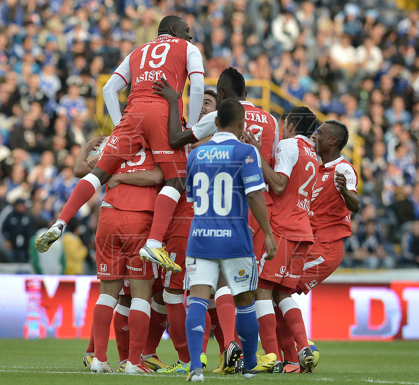 BOGOTÁ -COLOMBIA, 29-06-2013. Jugadores de Santa Fe celebran un gol en contra de Millonarios durante partido de los cuadrangulares finales, fecha 5, de la Liga Postobón 2013-1 jugado en el estadio el Campín de la ciudad de Bogotá./ Santa Fe players celebrate a goal against Millonarios during match of the final quadrangular 5th date of Postobon  League 2013-1 at El Campin stadium in Bogotá city. Photo: VizzorImage/STR
