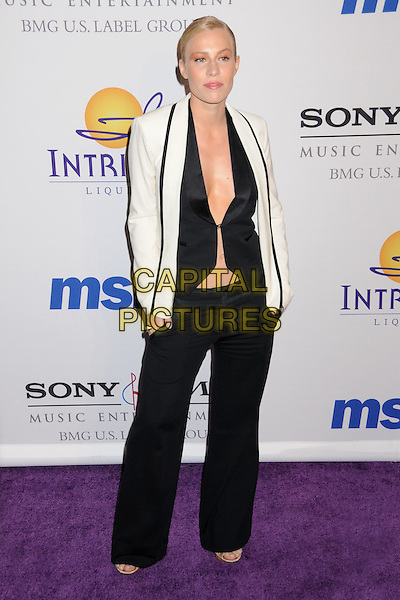 NATASHA BEDINGFIELD.Clive Davis 2008 Pre-Grammy Awards Party at the Beverly Hilton Hotel, Beverly Hills, California, USA..February 9th, 2008.full length trousers beddingfield white tuxedo jacket black top open unbuttoned cleavage .CAP/ADM/BP.©Byron Purvis/Admedia/Capital Pictures