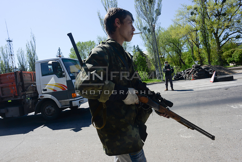 A young pro-russia activist protecting a check point near Slavyansk city from Ukrainian army