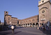 Mantova, Piazza delle Erbe, da sinistra Palazzo del Broletto, palazzo della Ragione e Torre dell'Orologio<br /> Mantua, Piazza delle Erbe with medieval buildings and the clock tower on the right.