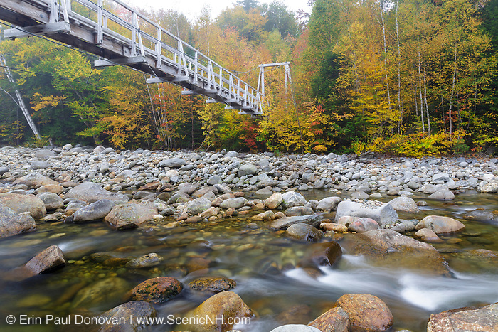 Foot bridge, which crosses the Peabody River at the start of the Great Gulf Trail in Green's Grant of the New Hampshire White Mountains on a foggy autumn morning.