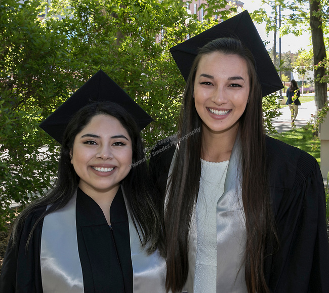 Yunuen Cycas and Carrina Bell during the University of Nevada College of Engineering, College of Science and Orvis School of Nursing graduation ceremony on Thursday evening, May 18, 2017.