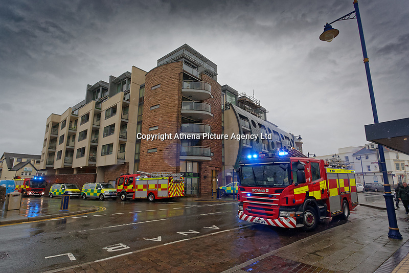 Pictured: Fire service attends an incident in Porthcawl, Wales, UK. Friday 12 October 2018<br /> Re: Strong winds and rain caused by Storm Callum in south Wales, UK.