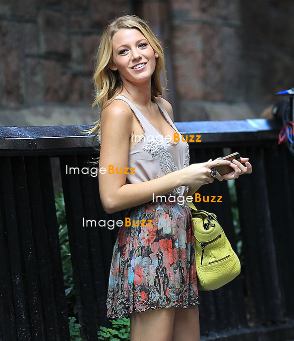 """Blake Lively chatting with friend on her cell phone while filming """" Gossip Girl """" in New York City..New York, August 3, 2012."""
