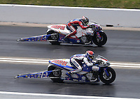 Apr. 28, 2013; Baytown, TX, USA: NHRA pro stock motorcycle rider Hector Arana Jr (near lane) races alongside Hector Arana Sr during the Spring Nationals at Royal Purple Raceway. Mandatory Credit: Mark J. Rebilas-