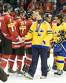 {header} - Team Sweden celebrates after defeating Team Switzerland 11-4 to win the bronze medal in the 2010 World Juniors tournament on Tuesday, January 5, 2010, at the Credit Union Centre in Saskatoon, Saskatchewan.