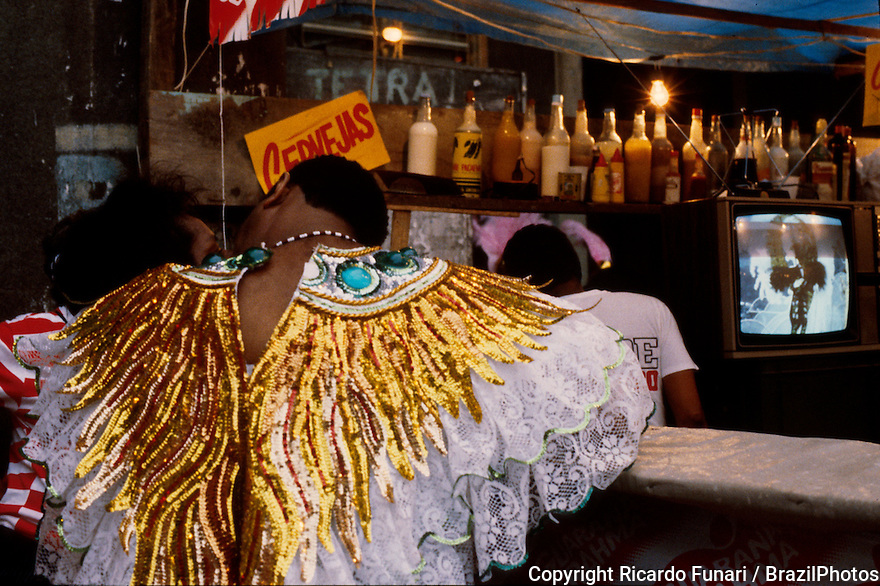 Carnival, Rio de Janeiro, Brazil - Preparation for Samba Schools Parade - Couple in love wearing costumes in a bar near Sambodromo waiting to participate in the Samba Schools Parade.