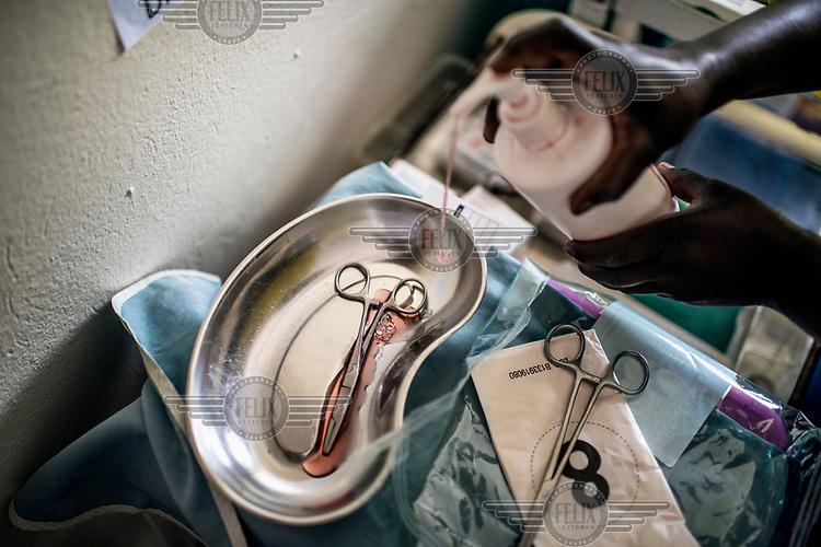A member of staff sterilises medical equipment at the RHU (Reproductive Health Uganda) clinic.