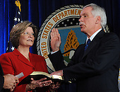 United States Secretary of Agriculture Ed Schafer takes the oath of office as his wife Nancy holds a bible during his Ceremonial Swearing-in at the U.S. Department of Agriculture in Washington on February 6, 2008.   <br /> Credit: Roger L. Wollenberg / Pool via CNP