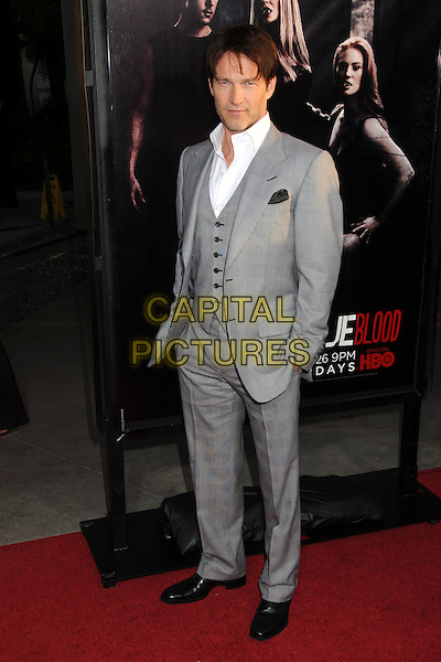 "Stephen Moyer.HBO's ""True Blood"" Season Four Los Angeles Premiere held at The Cinerama Dome, Hollywood, California, USA, .21st June 2011..full length grey gray suit  waistcoat white shirt black shoes hands in pockets .CAP/ADM/BP.©Byron Purvis/AdMedia/Capital Pictures."