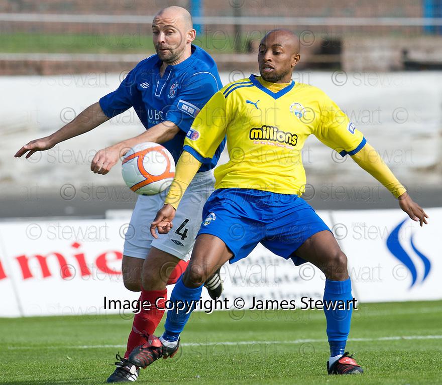 Cowdenbeath's Colin Cameron and Morton's Fouad Bachirou challenge for the ball ...