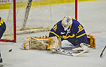 21 February 2015:  Merrimack College Warrior Goaltender Rasmus Tirronen, a Senior from Espoo, Finland, makes a second period save against the University of Vermont Catamounts at Gutterson Fieldhouse in Burlington, Vermont. The teams played to a scoreless tie to wrap up the regular home season for the Cats. Mandatory Credit: Ed Wolfstein Photo *** RAW (NEF) Image File Available ***