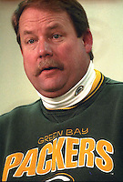 Green Bay Packers Coach Mike Holmgren addresses the press after the Packers 38-10 win over the Minnesota Vikings on December 22, 1996.
