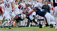 10/22/16<br /> Arkansas Democrat-Gazette/STEPHEN B. THORNTON<br /> Arkansas'  is brought down Rawleigh Williams (22) fights for yardage but is brought down during the first quarter of their game Saturday at Jordan-Hare Stadium in Auburn, Ala.