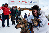 Travis Beals poses with his leaders in the finish chute in Nome after taking 5th place during the 2019 Iditarod on Wednesday March 13<br /> <br /> Photo by Jeff Schultz/  (C) 2019  ALL RIGHTS RESERVED