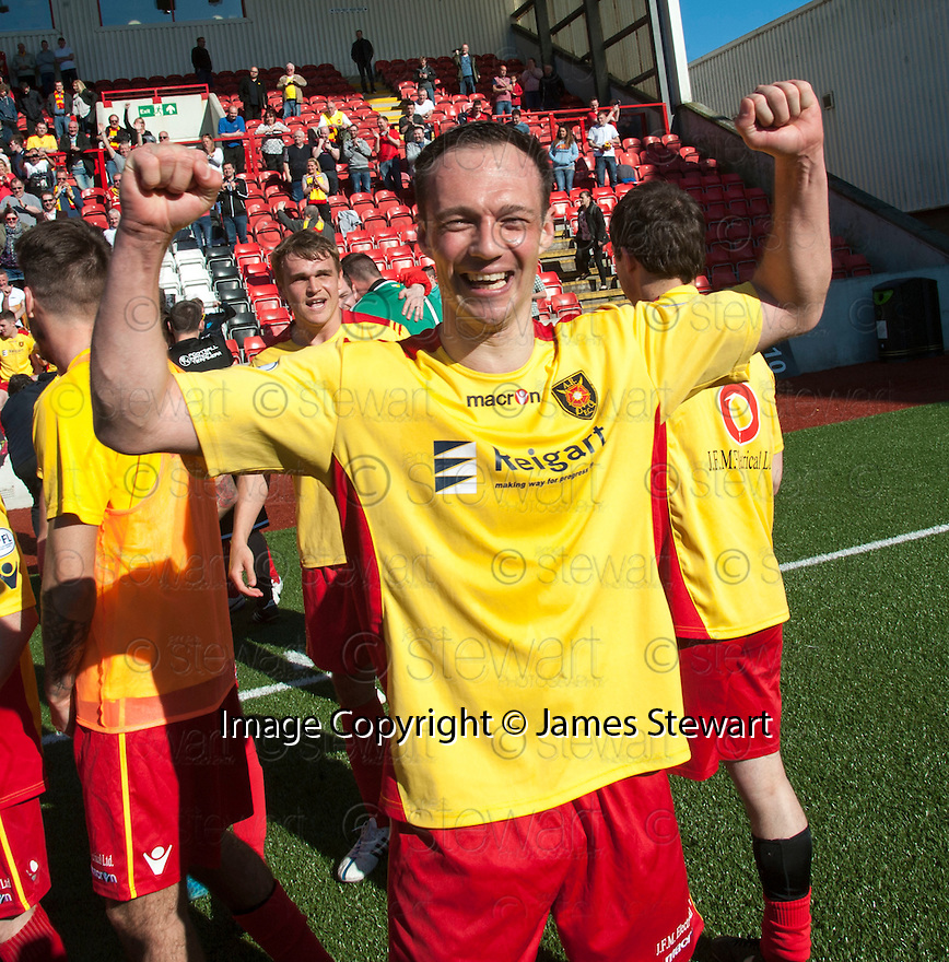 Albion manager Darren Young celebrates at the end of the game after winning the SPFL League Two.