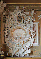 The Taking of Troy, high relief stucco frame by Rosso Fiorentino, 1535-37, in the Galerie Francois I, begun 1528, the first great gallery in France and the origination of the Renaissance style in France, Chateau de Fontainebleau, France. The Palace of Fontainebleau is one of the largest French royal palaces and was begun in the early 16th century for Francois I. It was listed as a UNESCO World Heritage Site in 1981. Picture by Manuel Cohen
