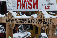 The famed Burl Arch finish line in Nome on Friday March 14 during the 2014 Iditarod Sled Dog Race.<br /> <br /> PHOTO (c) BY JEFF SCHULTZ/IditarodPhotos.com -- REPRODUCTION PROHIBITED WITHOUT PERMISSION